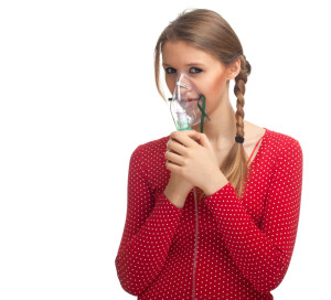 inhalation young woman keeping inhale mask, isolated